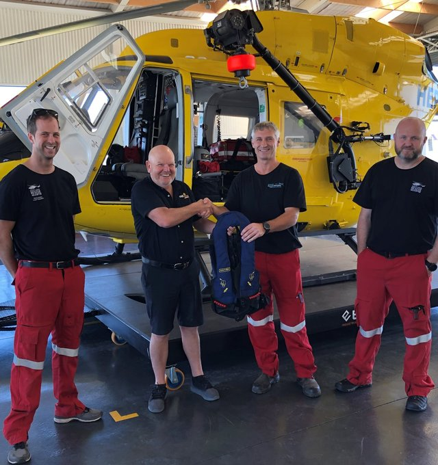Neil from MTF Finance Gisborne donating a set of  life vests to Eastland Helicopter Rescue Trust